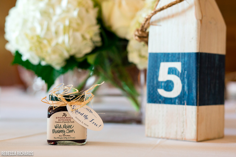 Reclaimed lobster buoy for table number and blueberry jam favors   unique Maine wedding trend idea